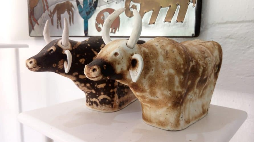 Raku fired nguni cow statues available at Porcupine at Old Nick Village, Plettenberg Bay