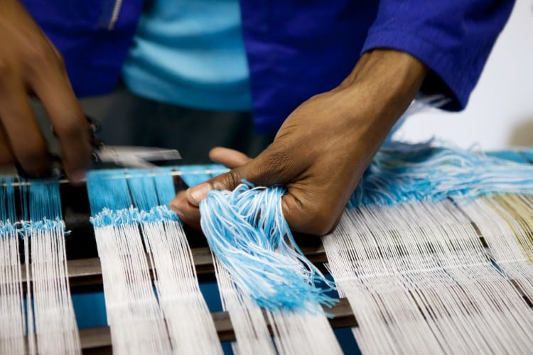 Threads being tied on at the weaving museum